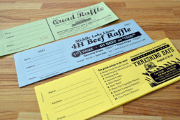 Raffle Tickets on Coloured Paper with Black Ink