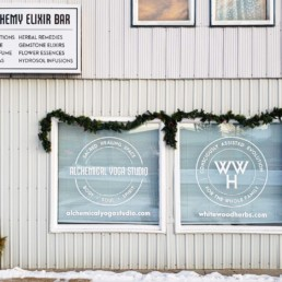 Exterior Building Sign and Window Decals for White Wood Herbs in Lanigan, SK
