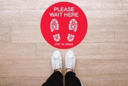 Please Wait Here Round Floor Graphic